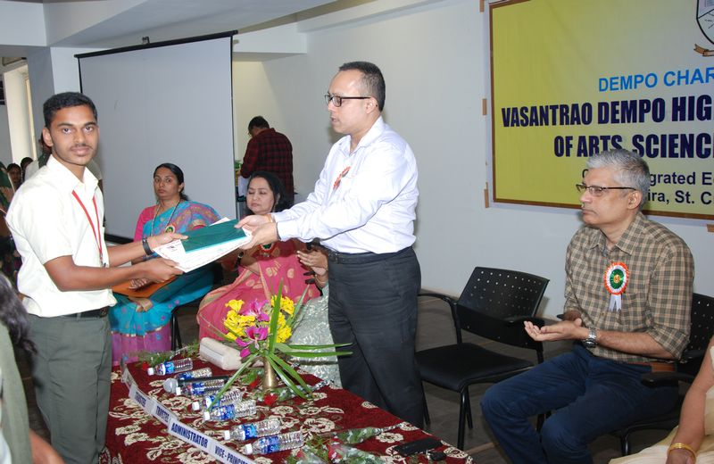 Student Mast. Arakhit Patro seen receiving a certificate at the hands of the Chief Guest of the Cultural Prize Distribution Ceremony, Mr. Yatish Dempo, Trustee of Dempo Charities Trust.