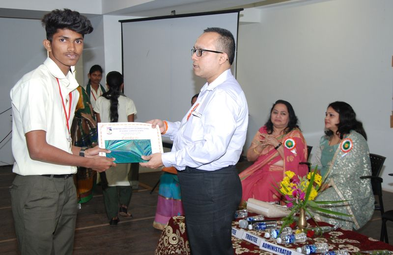Student Mast. Touseef Buddanavar seen receiving a certificate at the hands of the Chief Guest of the Cultural Prize Distribution Ceremony, Mr. Yatish Dempo, Trustee of Dempo Charities Trust.